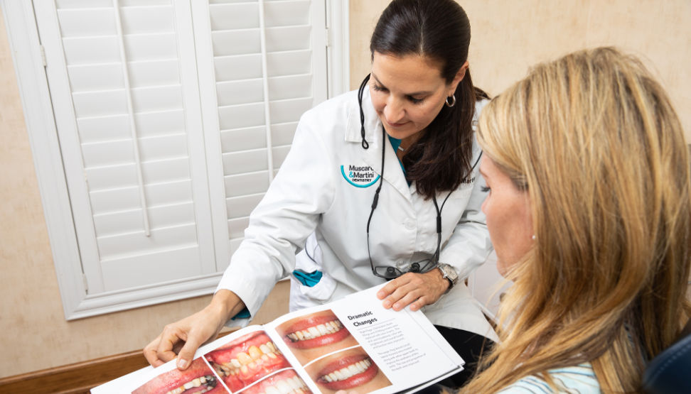 Dr. Martini with patient looking at images of porcelain veneers