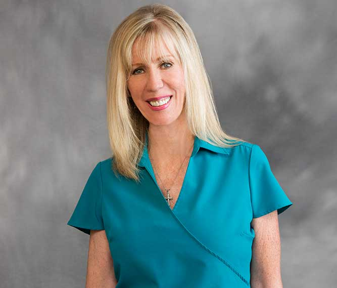 patient care specialist staff member Cindy Hicks of Muscaro and Martini Dentistry in Tampa FL