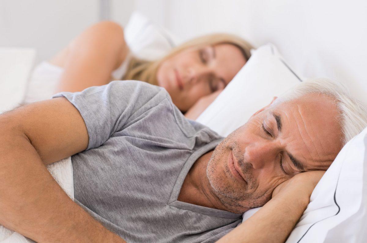 Senior married couple asleep